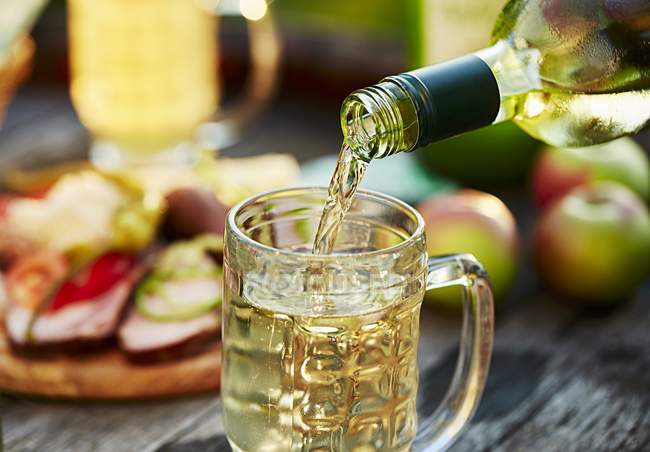 Closeup view of pouring Cider to glass — Stock Photo