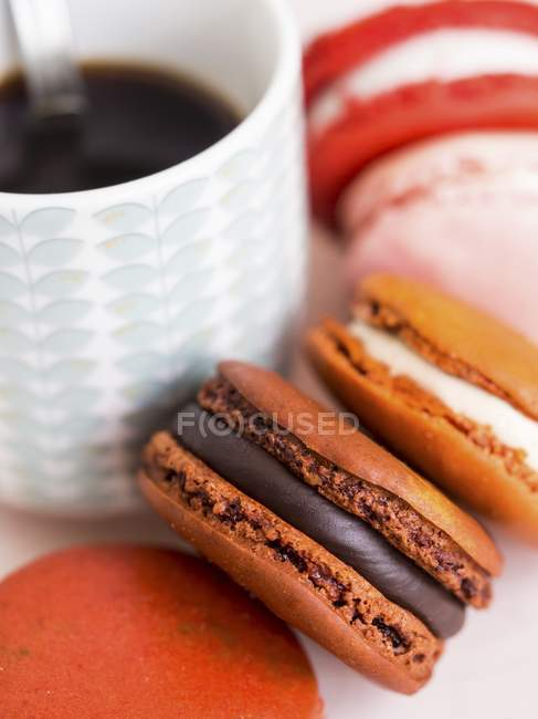 Colorful Macarons and cup of coffee — Stock Photo