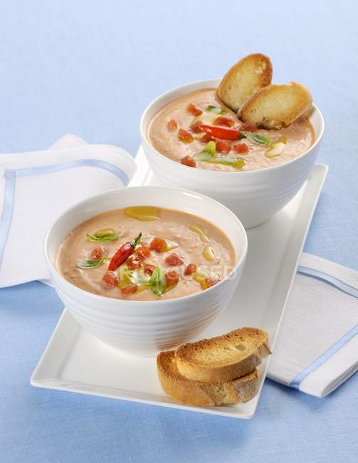 Creamy tomato soup with toasted bread — Stock Photo
