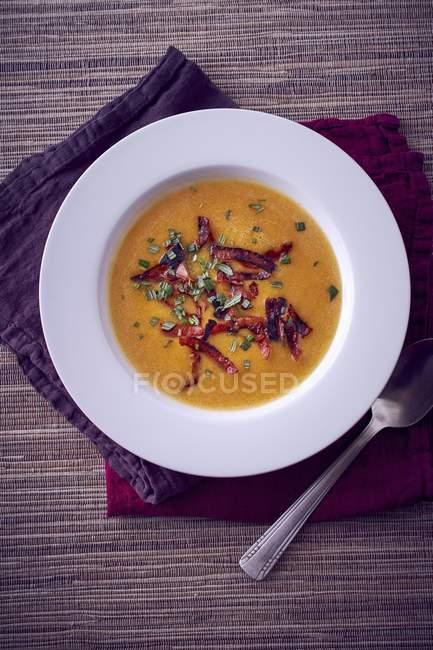 Pumpkin soup with chorizo — Stock Photo