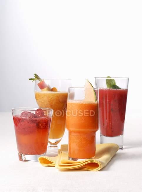 Various fruit smoothies on table — Stock Photo