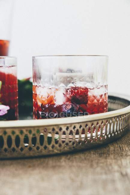 Closeup view of berry drink with ice cubes — Stock Photo