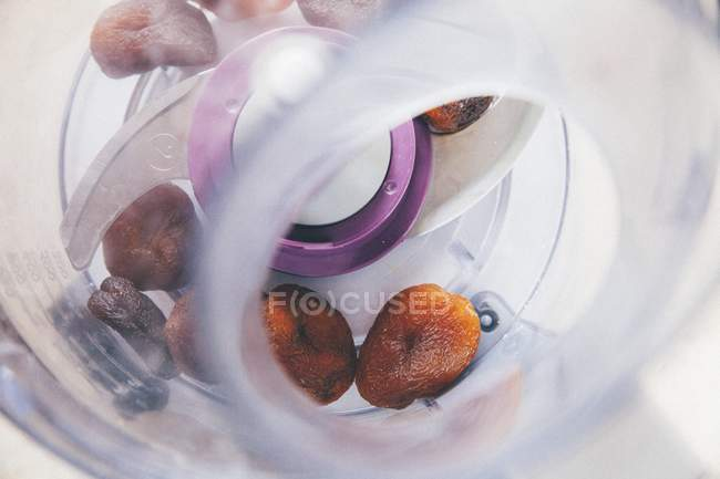 Closeup view of dried fruits in a mixer — Stock Photo