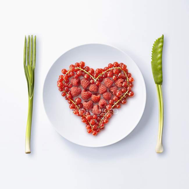 Heart made with summer fruit  on white plate — Stock Photo