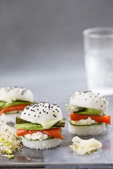 Three sushi burgers with smoked salmon — Stock Photo