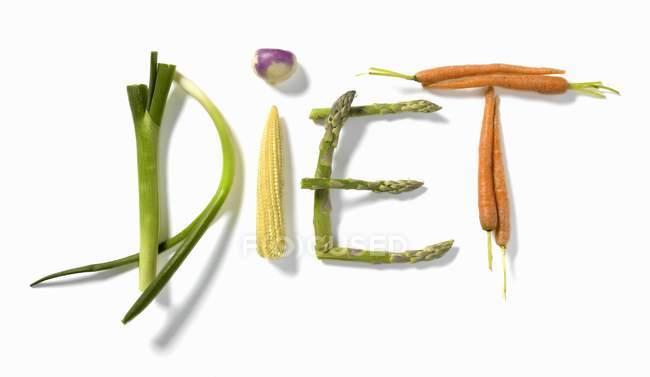 Слово, написанное с овощами — стоковое фото