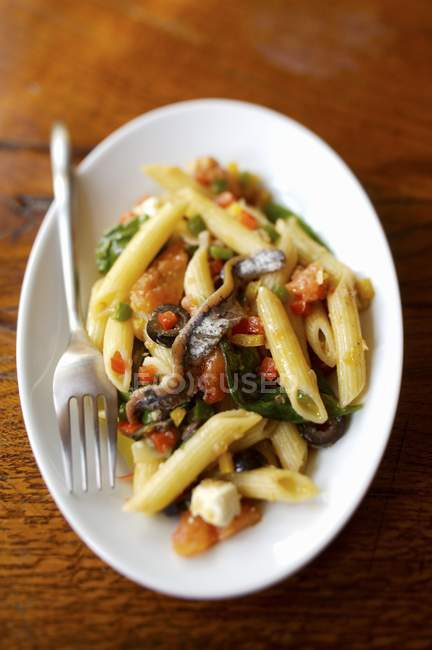 Penne pasta with anchovy and el fricasse — стоковое фото