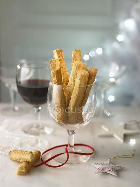 Cheese straws and wine — Stock Photo