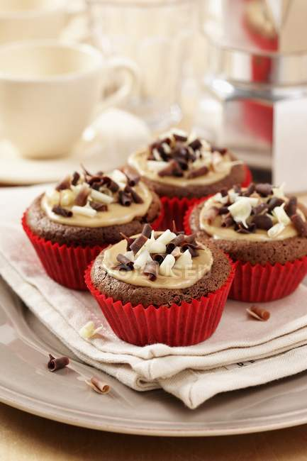 Mocha chestnut cupcakes on cream napkin — Stock Photo