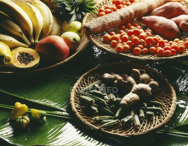 Selection of exotic products on green leaves — Stock Photo
