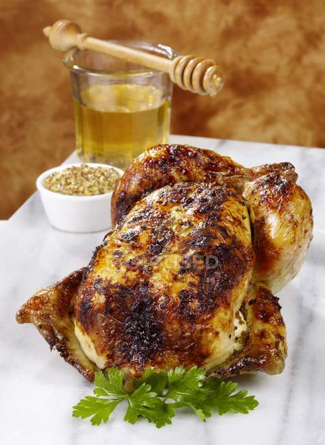 Whole cooked roast chicken — Stock Photo