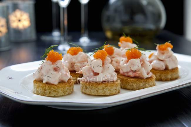 Closeup view of canapes with shrimp and bleak roe — Stock Photo
