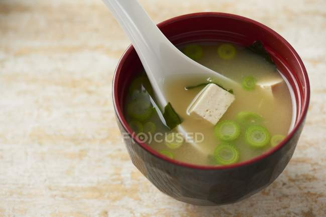 Closeup view of Miso soup in traditional Japanese bowl — Stock Photo