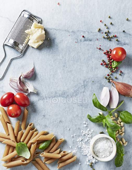 Arrangement of assorted ingredients for pasta dish — Stock Photo