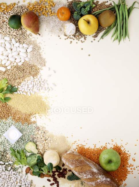 Table with fruits, nuts, nuesli and vegetables — Stock Photo