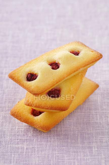 Raspberry Financiers on tablecloth — Stock Photo