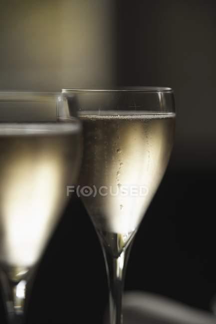 Elegant glasses of cold champagne — Stock Photo