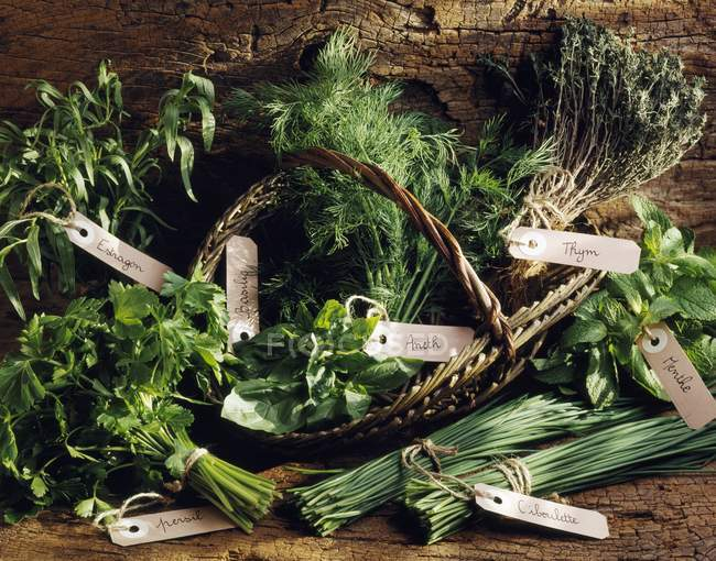 Closeup view of selection of bunched herbs with tags — Stock Photo
