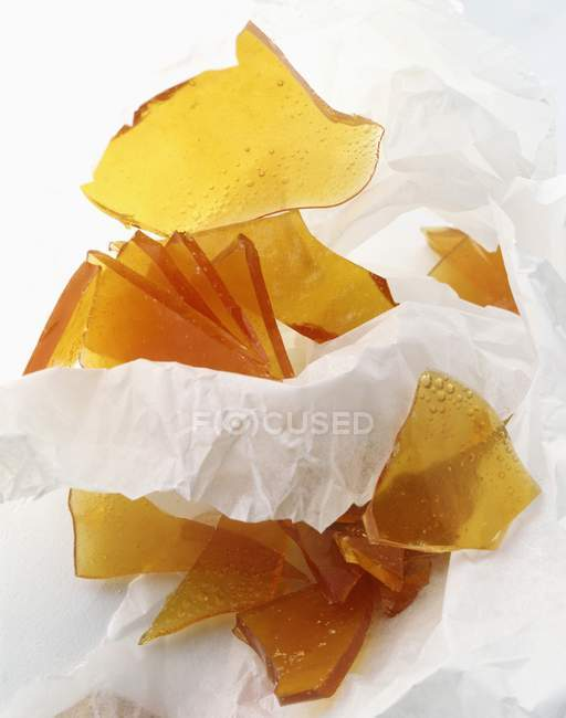 Caramel pieces in paper — Stock Photo