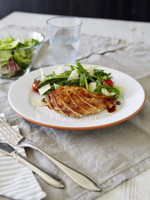 Fish and chips with flower salad — Stock Photo