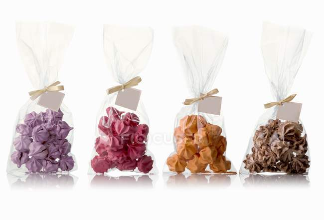 Four bags of different flavored meringues — Stock Photo