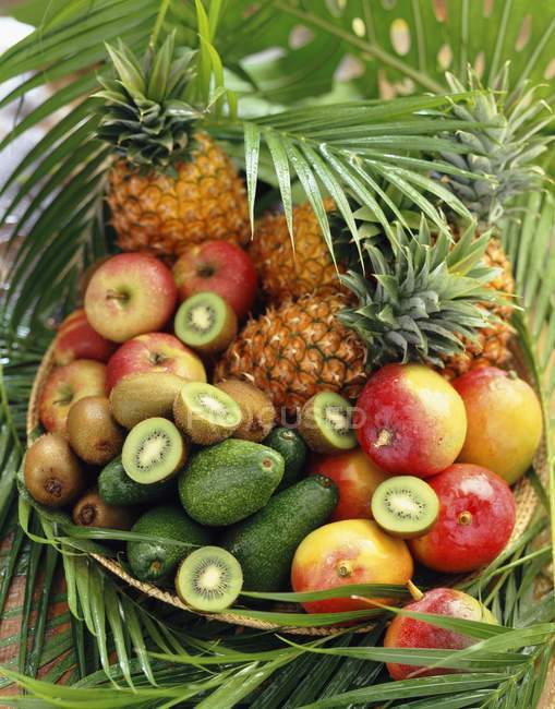 Basket of exotic fruits — Stock Photo