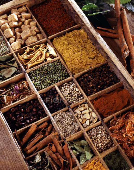 Selection of spices in woden crates — Stock Photo
