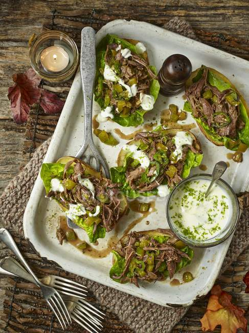 Baked potato skins with  lamb shoulder — Stock Photo