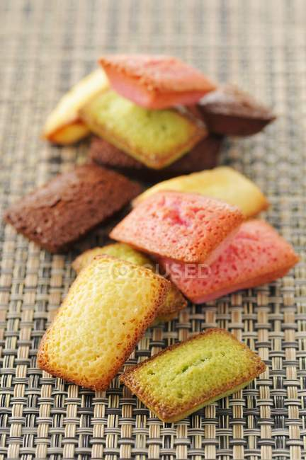 Different-flavored mini Financiers — Stock Photo