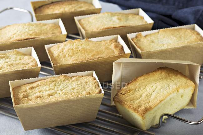 Taking Financiers out of their moulds — Stock Photo