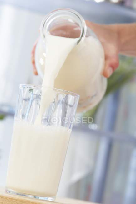 Glass and bottle of milk — Stock Photo