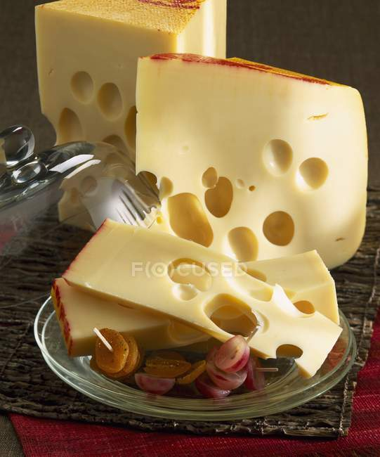 Emmental cheese on desk — Stock Photo