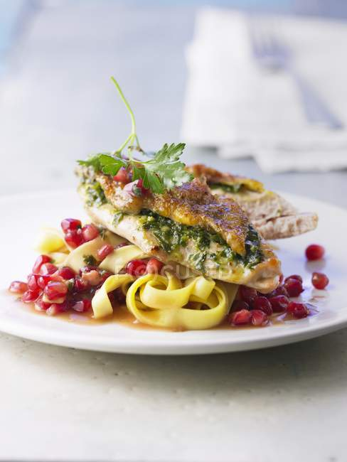 Roasted guineafowl breast with tagliatelle pasta — Stock Photo