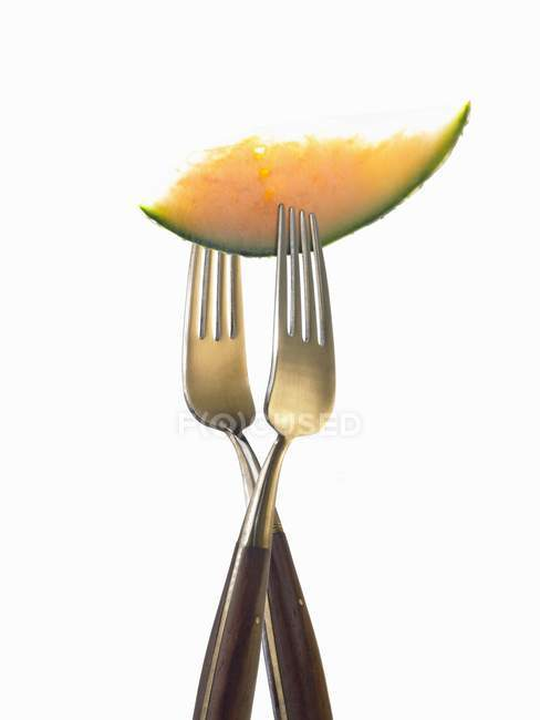 Closeup view of two forks with slice of melon — Stock Photo