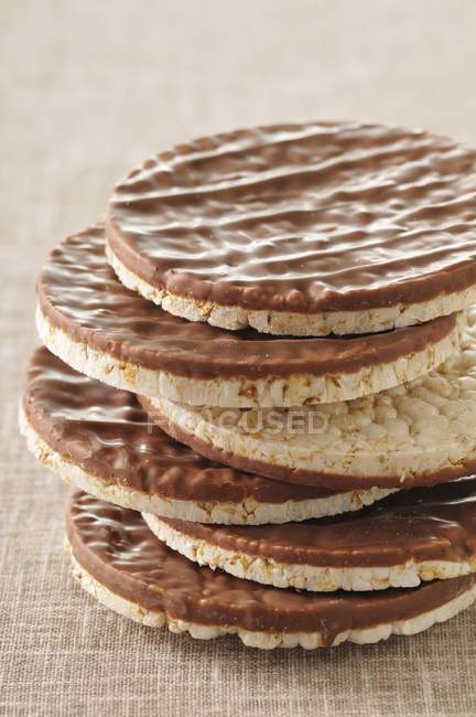 Rice cakes coated in chocolate — Stock Photo
