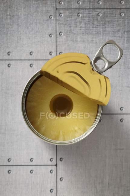 Open tin of pineapples — Stock Photo