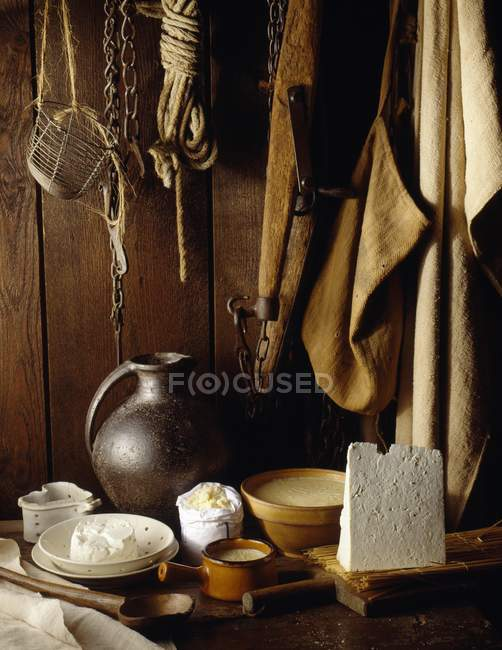 Still life with Cancoillotte cheese and different kitchen utensils — Stock Photo