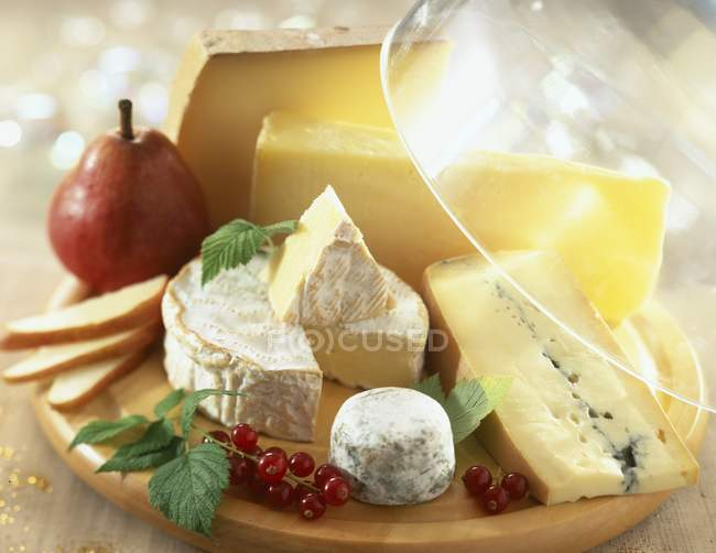 Cheese platter with food — Stock Photo