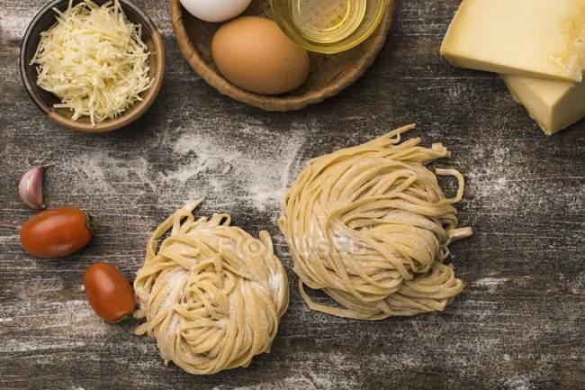 Fresh raw linguine pasta nests — Stock Photo