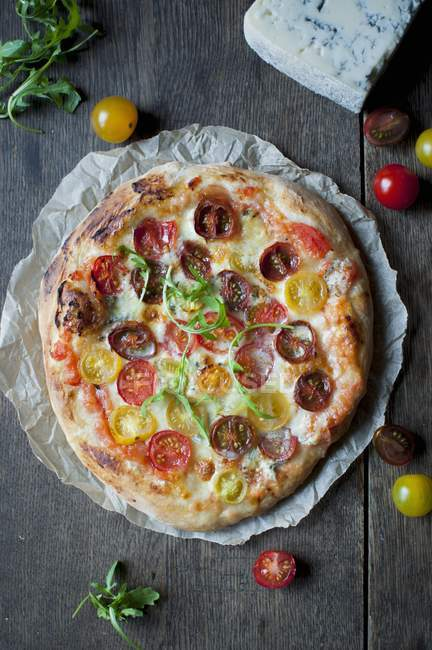 Homemade pizza with cherry tomatoes — Stock Photo
