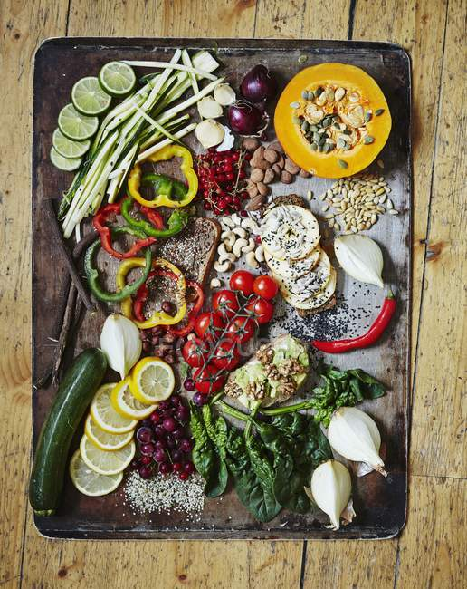 Various vegetables on a vintage tray Healthy greens on wooden  surface — Stock Photo