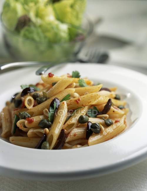 Penne pasta with capers — Stock Photo