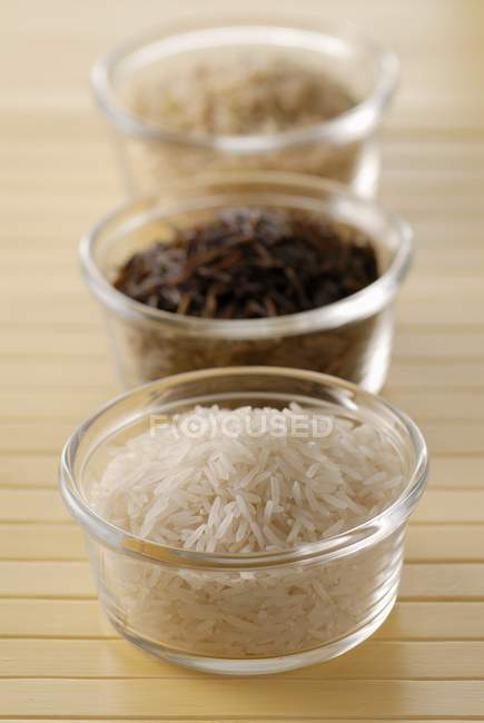 Different kinds of uncooked rices — Stock Photo