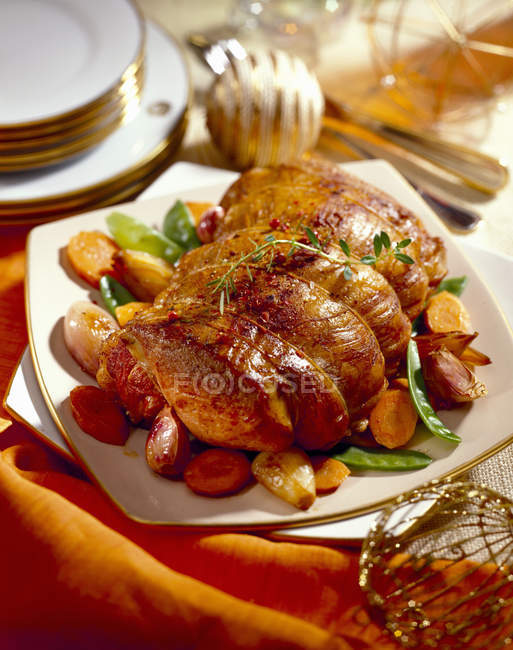 Roast veal with spring vegetables — Stock Photo