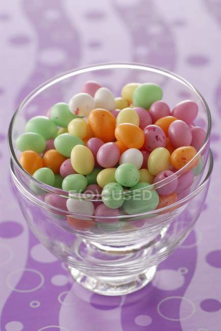 Closeup view of colorful candies in glass bowls — Stock Photo