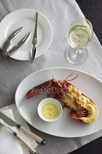 Top view of gratinated lobster half with saffron sauce — Stock Photo