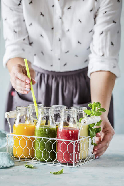 Various smoothies in a drinks holder — Stock Photo