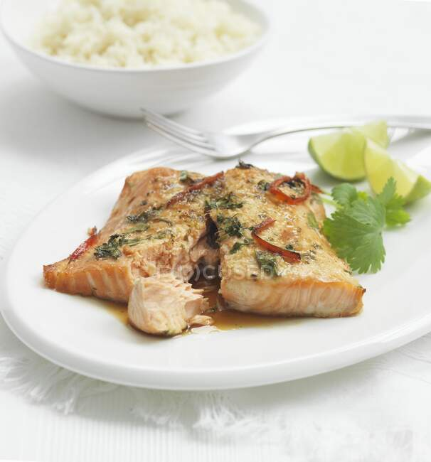 Salmon fillet with coriander, lime and rice — Stock Photo