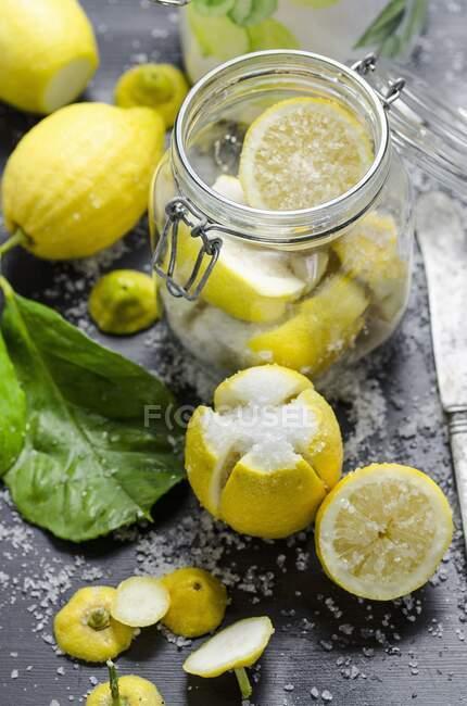 Lemons being soaked in salt — стокове фото