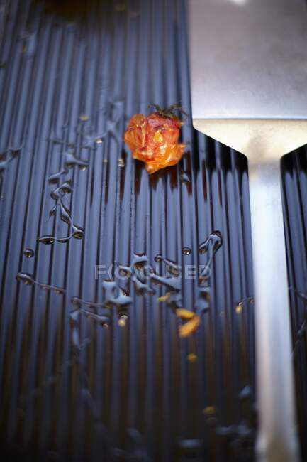 Leftover grilled tomato close-up view — Stock Photo